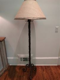 Lonely metal floor lamp, with shade.
