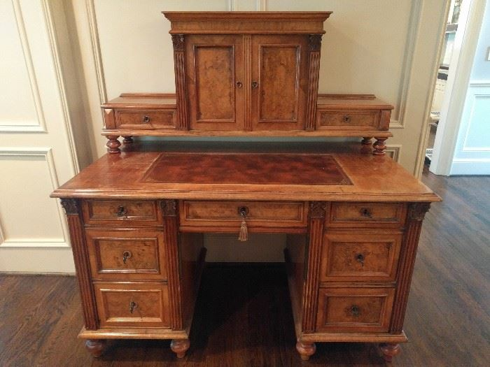 "Antique English writing desk, with burl wood, all keys and a leather inlay.                                                        Would be PERFECTO as a modern work desk, as the top portion opens to reveal a correct-sized computer screen.                                                                                The desk itself measures 2' 6"" deep x 4' 6"" wide x 31"" tall. The top part measures 4' 8"" tall (from the floor) x 11"" wide x 4' 4"" wide."