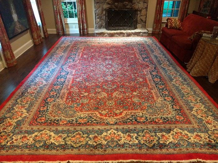 Vintage Persian Kerman, hand woven, 100% wool face, measures 11' x 17'.