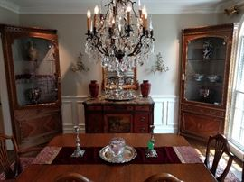 Wider view of the dining room, with an antique pair of lighted corner cabinets from Barcelona.