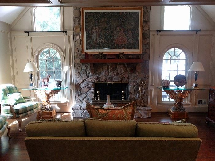View of the great room. The stone fireplace is flanked pair of UNBELIEVABLE  gilt wood Italian console tables, with very thick, beveled glass, L-R facing. You won't often see a pair of this quality. The original cost of each eagle, without the glass tops was $2K.                              I knoooooow!