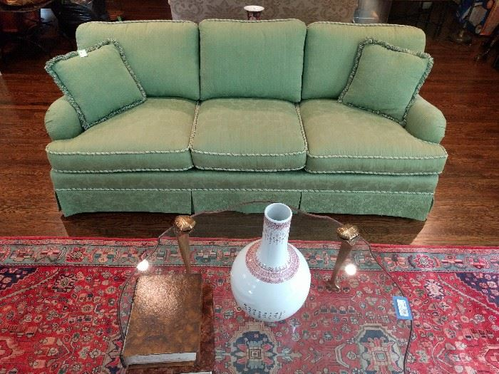 Beautifully upholstered green damask couch, with corded gimp and fringed pillows - very sha sha sha!