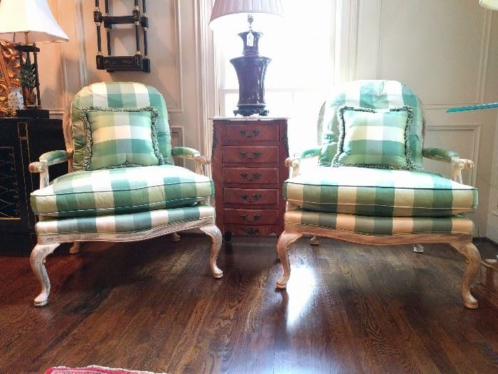 Beautiful pair of silk plaid, balloon-backed bergere chairs, by Wesley Hall (Hickory, NC). Vintage French, marble-topped chest, with five drawers between the chairs, topped with an oxblood Asian lamp.