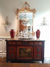 "1930's mahogany chest, hand painted, with marble top, measures 4' 5"" W  x 1' 11"" D x 35"" T, silver plated tea set, pair of red Asian vases, flanked by a pair of metal Italian toile wall sconces, vintage LaBarge Gilt wood mirror."
