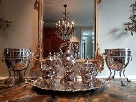 English silver plated tea set, reflected in a vintage LaBarge gilt wood mirror, flanked by a pair of exquisite French silver plated champagne coolers.