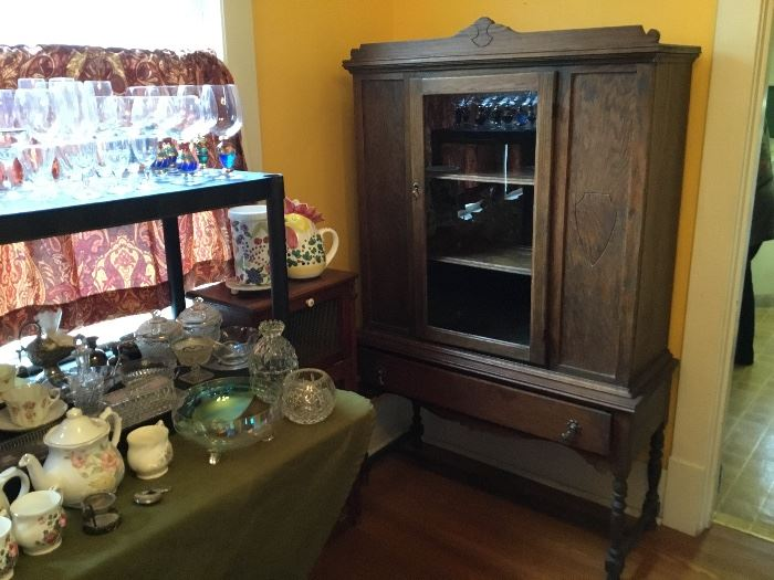 Antique glass front China cabinet.