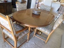 Drexel Dining  Set, round table with leaf becomes oval. 4 chairs (2 captain) base of table has brass accents $350 for the set