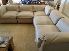 Low mid-century L shaped sofa grouping, can be configured to your liking. Faux (?) Leather