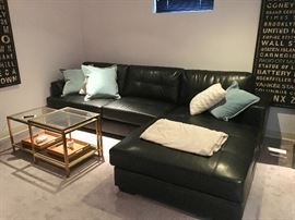 Another black leather sofa & tables