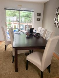 Contemporary dining room table with 8 upholstered chairs