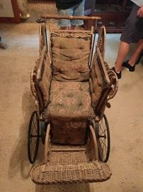 Antique wicker baby buggy