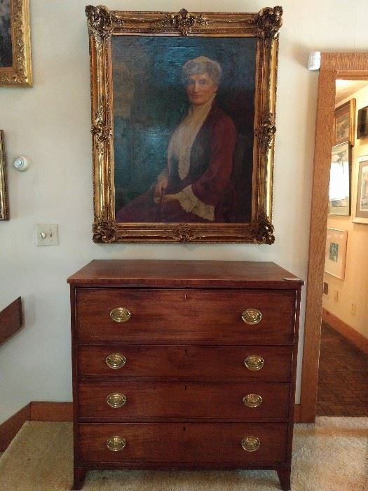 Meet great Aunt Hulga. She's a distant relative of John Updike, from Amsterdam. She's looks like a Cloris Leachman doppelganger and is quite the stunner in an antique wooden (NOT resin) gilded frame, she was rescued from the Candler estate when the owner bought her at an estate sale in the 70's. She's well-hung, lording over an antique English mahogany 4-drawer chest, with pencil inlay.