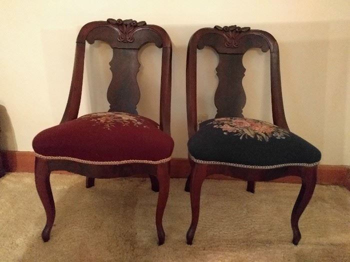 Another cute pair, with needlepointed seats.