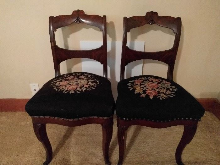 Love all the needlepoint work on these chairs. I wouldn't do it.