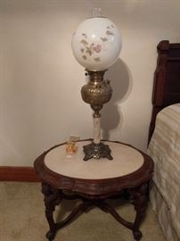One of a zillion Gone with the Wind lamps, on a marble-topped side table.