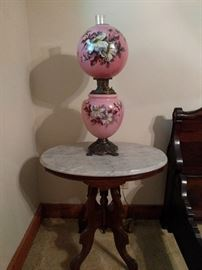 One of several marble-topped Victorian side tables and one of the 30 Gone with the Wind lamps in this house.