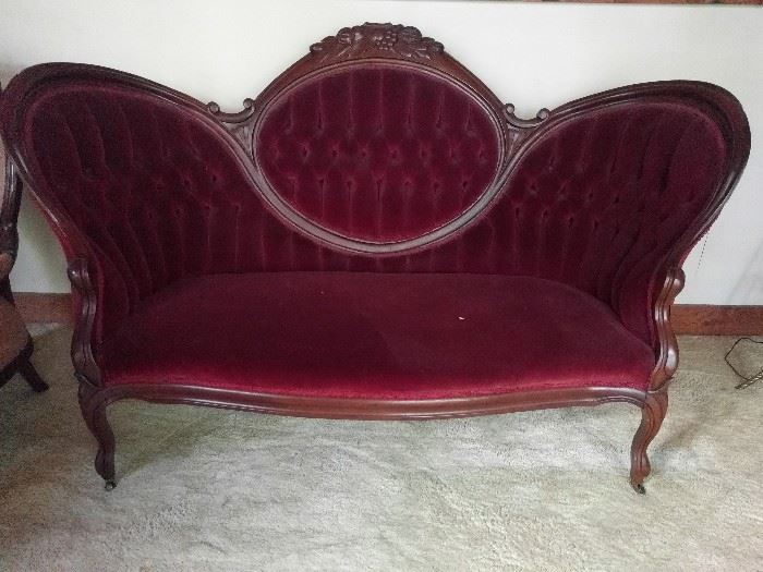 "Bitchy looking Victorian red velvet couch.                         I think this one was rescued from the set of Bonanza, from one of their bordello episodes.                         Where do you think ""Miss Kitty"" got her name?!?"