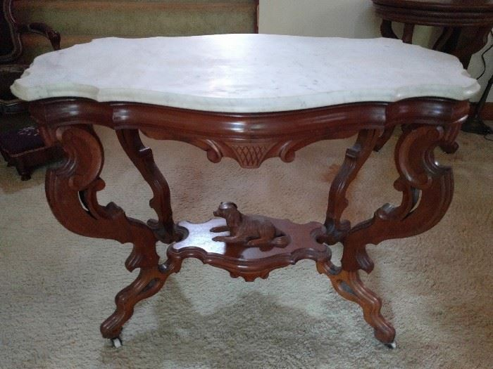 LOVE this Victorian marble-topped table! The beveled edge marble and carved dog on the wooden stretcher is excellent!