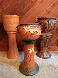 "Holy Trinity of Roseville Pottery!                                        L-R:                                                                                            -R R P (Robinson-Ransbottom Pottery) # 412-11""            -Zephyr Lily 671-8"" Jardiniere Pedestal                               -Roseville Florentine Jardiniere Pedestal"