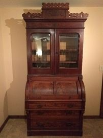Victorian burled walnut secretary, with wavy glass front.