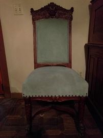 Very nicely carved oak chair, with baby blue velvet upholstery, beautifully carved dolphin legs.