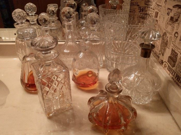 NICE collection of crystal decanters. They're all represented here: Baccarat, Waterford, Cartier, ABCG and a couple of good looking wannabes, one with an English sterling collar.