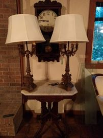 Very nice pair of vintage metal table lamps, with new shades, atop yet another Victorian marble topped side table. Oh, look, an oak wall clock!