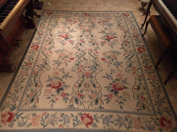 "Portugese needle point rug, 100% wool face, handwoven, measures 7' 8"" x 9' 10""."