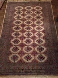 "Pakistani Bokhara rug, 100% wool face, handwoven, measures 6' 1"" x 8"" 11""."