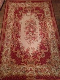Portugese needle point rug, 100% wool face, handwoven, measures 6' x 9'.