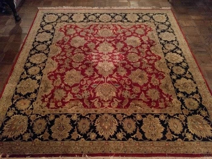 "Persian Kashan design rug, 100% wool face, hand woven, measures 7' 11"" x 8"" 1""."