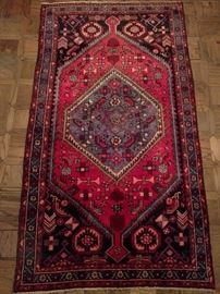 Vintage hand woven Persian Viss rug, 100% wool face, measures 4' x 7'.