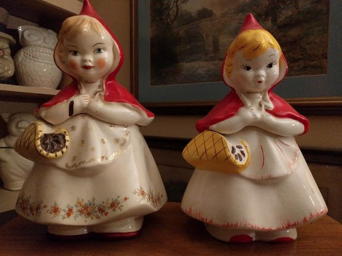 Sibling rivalry Little Red Riding Hood cookie jars, one by McCoy, the other by Hull, #967.