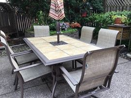 Large outdoor patio table, six chairs and umbrella