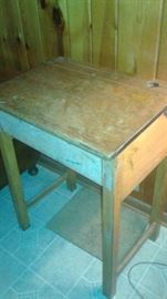 this is an old desk. Notice the old ink well hole