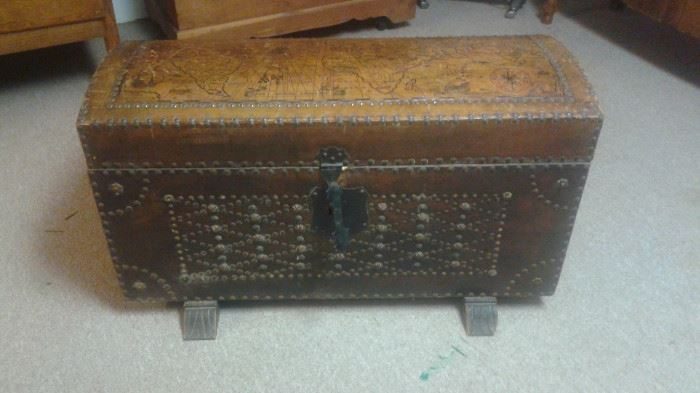 VERY UNIQUE!!! Antique studded Leather Trunk. has a design on lid