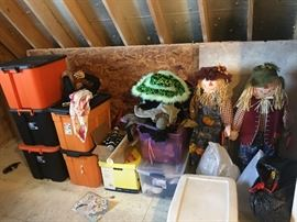 Halloween decor with totes full of costume pieces