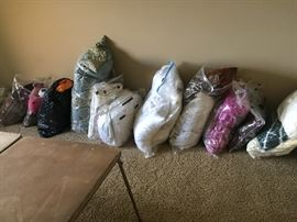 Bags full of bedding-comforters, spreads, pillows, etc