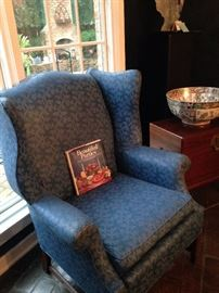 One of two blue wingback chairs