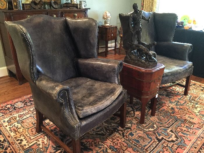 Distressed Navy Leather arm chairs with nailhead details.