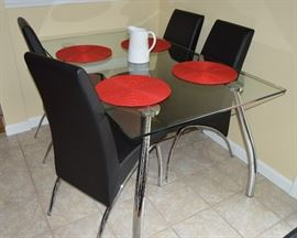 Glass on Chrome Dining table with Mensa black chairs