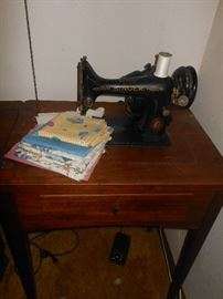 Working Singer sewing machine in cabinet with bench