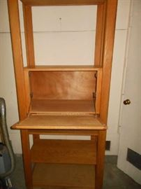 Drop front shelf unit