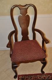 One of the two captain chairs included in the dining table by Universal Furniture
