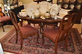 """Wonderful mahogany dining table by Universal Furniture is complete with two 15"""" leaves ,2 captain chairs and 4 side chairs.  Table closed is 64"""" l x 30""""h x 42""""w"""