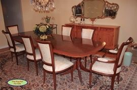 Quality Wood Dining Table with Eight Chairs. The Table and Chairs are In Excellent Condition and the Chairs have a Beautiful White/Gold Delicate Print