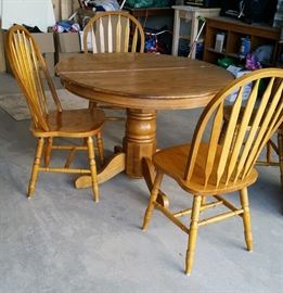 oak dinner table and leaf.  note the base & 1 leg  needs repair. chairs sold separately.