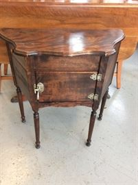 Wonderful smoking stand with pull out ashtray. Lined humidor