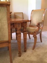 Carved wood dining table and chair detail