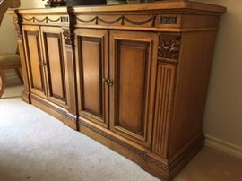 Wood buffet with double doors and drawers inside, matches style of dining table and chairs